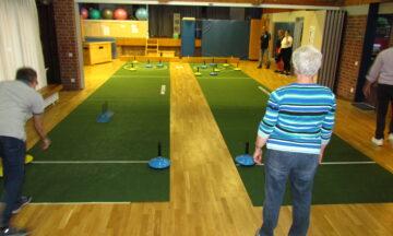 Teppich-Curling: Schwungvoll und zielgenau